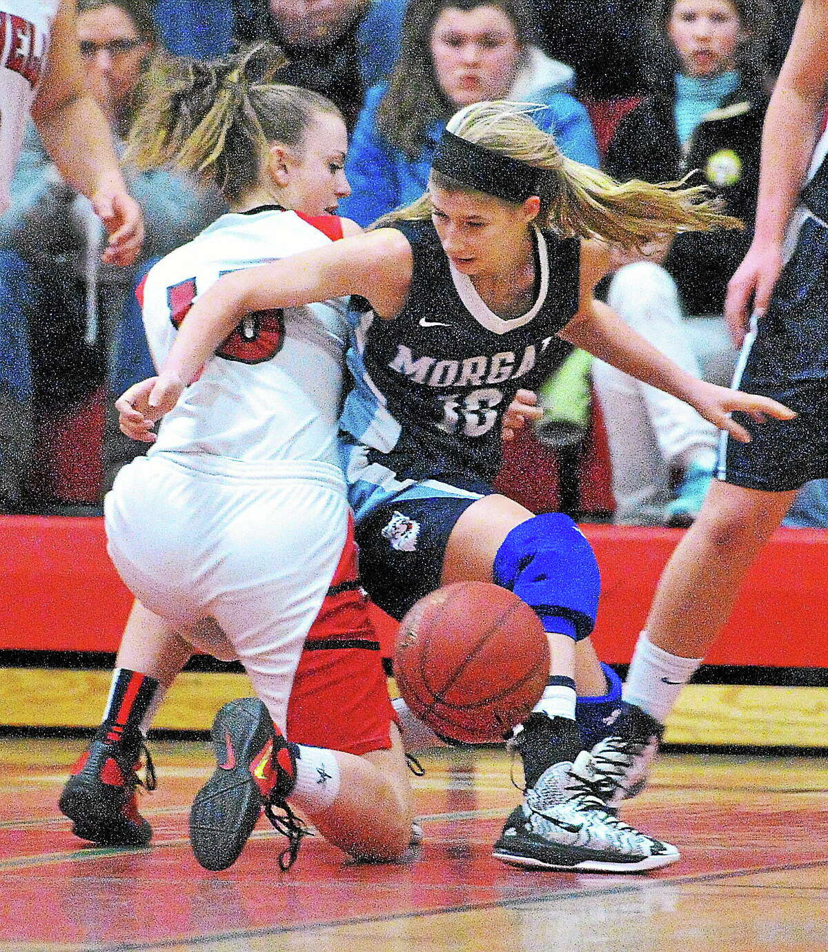 Morgan's Sami Ashton gets tied up with Cromwell's Emma Belcourt during the second quarter of the SLC Championship.