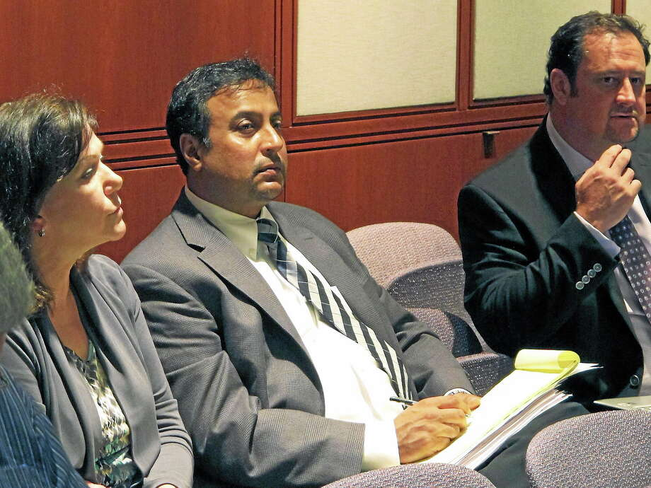 (AP Photo/Dave Collins) Dentist Rashmi Patel, middle, sits with supporters during a hearing before the Connecticut State Dental Commission on Wednesday, June 18, 2014, in Hartford, Conn. Photo: AP / AP