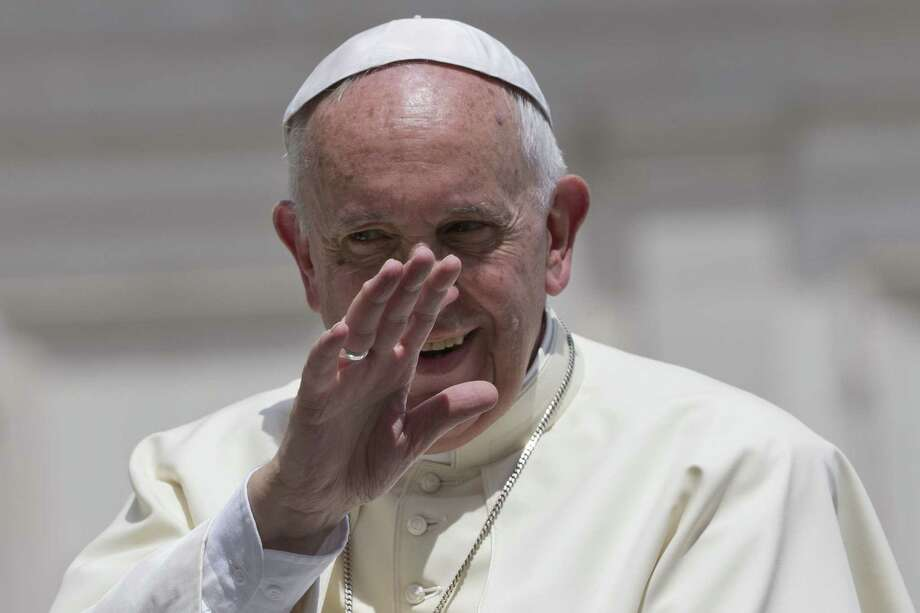 Pope Francis waves as he leaves at the end of his weekly general audience, in St. Peter's Square at the Vatican,  Wednesday, June 17, 2015. (AP Photo/Andrew Medichini) Photo: AP / AP