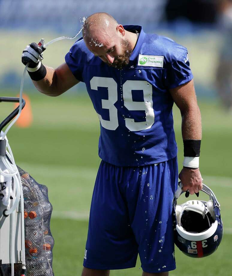 In this July 27, 2013 file photo, New York Giants safety Tyler Sash cools off at a water fountain during training camp in East Rutherford, N.J. Photo: Julio Cortez — The Associated Press File Photo  / AP