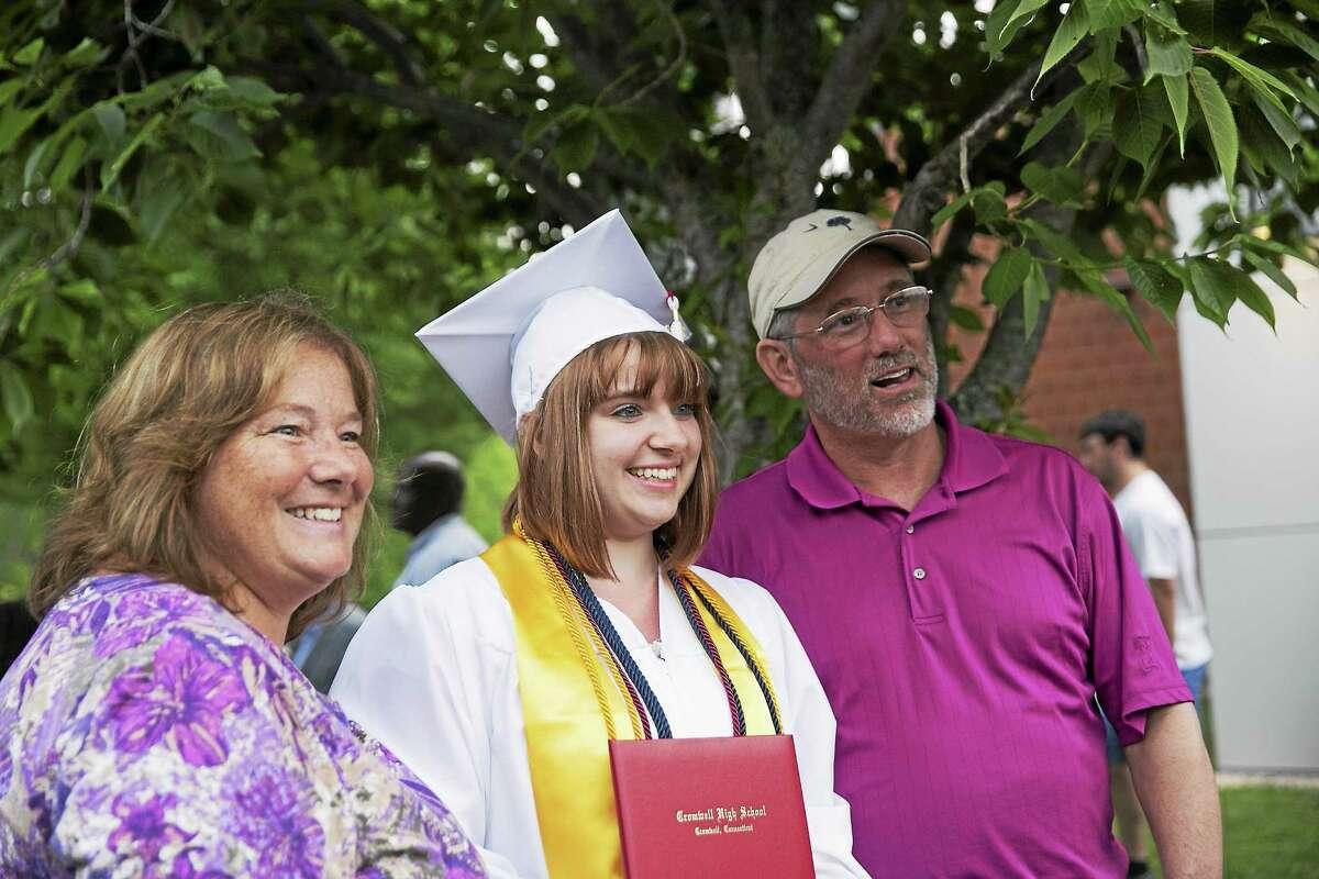 Sandy Aldieri - Special to the Press Cromwell High School seniors transformed into alumni on June 17, 2015.