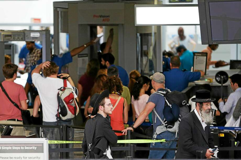 A security checkpoint is pictured at Newark Liberty International Airport on July 24, 2014 in Newark, N.J. Photo: AP Photo  / AP