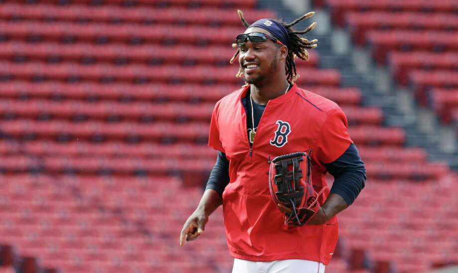 New Boston Red Sox boss Dave Dombrowski says the team is committed to playing Hanley Ramirez at first base next season. Photo: Charles Krupa — The Associated Press File Photo  / AP