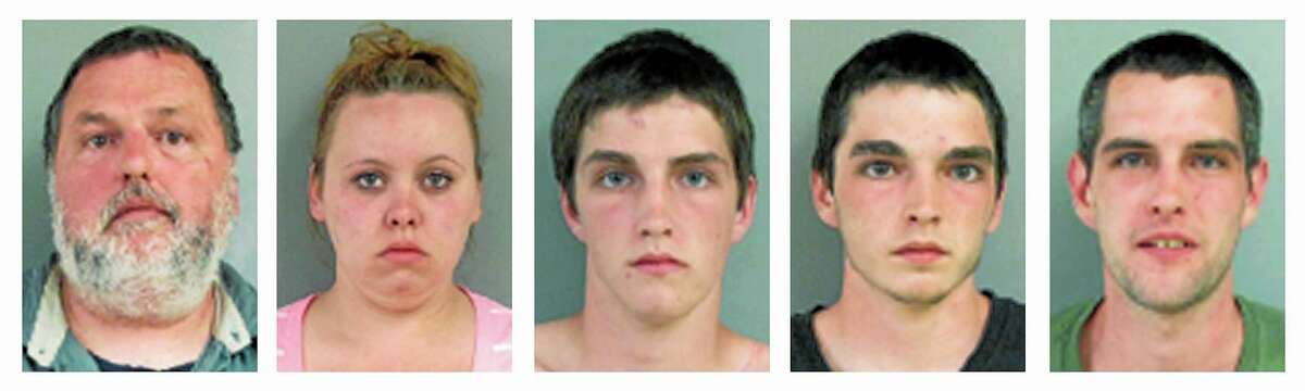 This panel of booking photographs released by the Salem, N.H., Police Department show from left, Allen, Ashley, Brian, Damian and Joshua Perry, arrested on a variety of charges Monday, June 16, 2014, for assaulting police officers during a melee that erupted when security guards at Canobie Lake amusement park told them to leave their knives in the car.