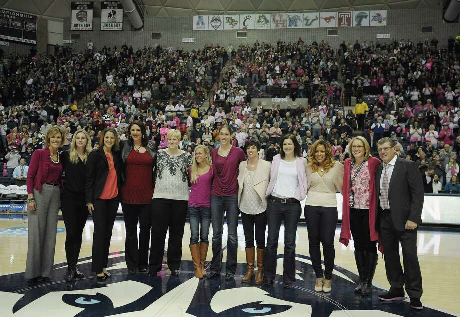 Members of the 1994-95 UConn women's basketball team are honored during halftime of the Huskies' 87-39 win over Tulane on Saturday afternoon at Gampel Pavilion in Storrs. Photo: Jessica Hill — The Associated Press  / AP