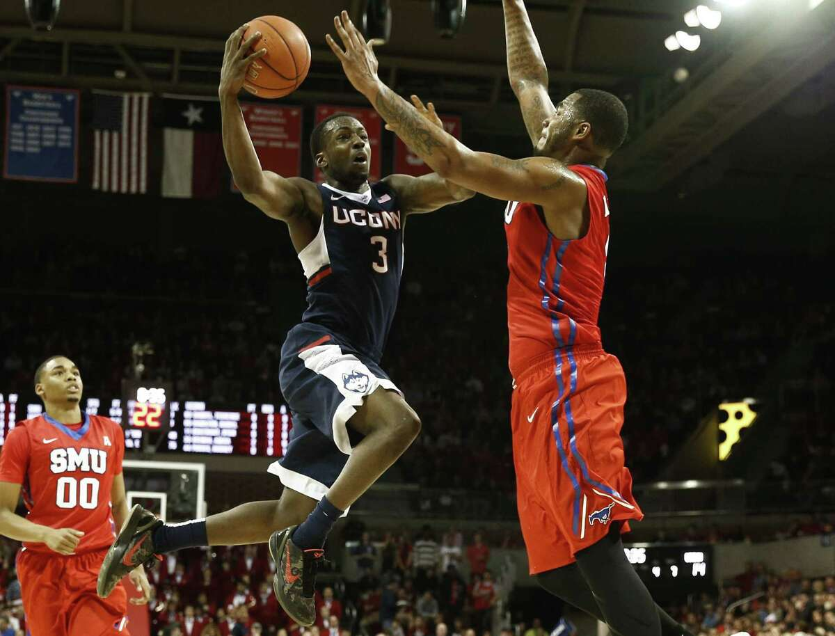 UConn's Terrence Samuel (3) shoots the ball in front of SMU's Markus Kennedy during the first half Saturday.