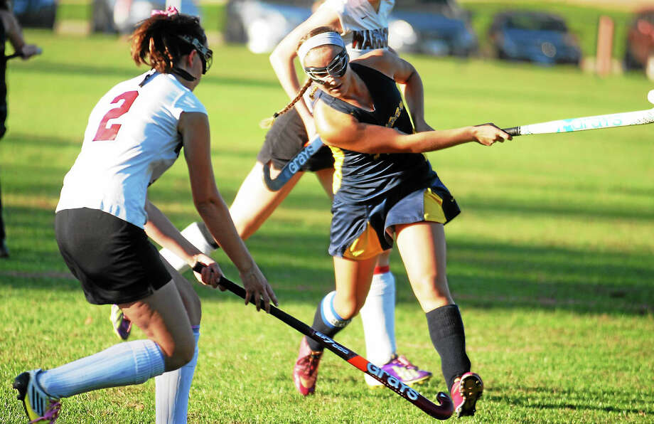 H-K senior co-captain Julie Hausherr fires a shot as Valley Regional defender Leslie Clapp (#2) moves in. The Cougars prevailed, 1-0. Photo: Jimmy Zanor – The Middletown Press