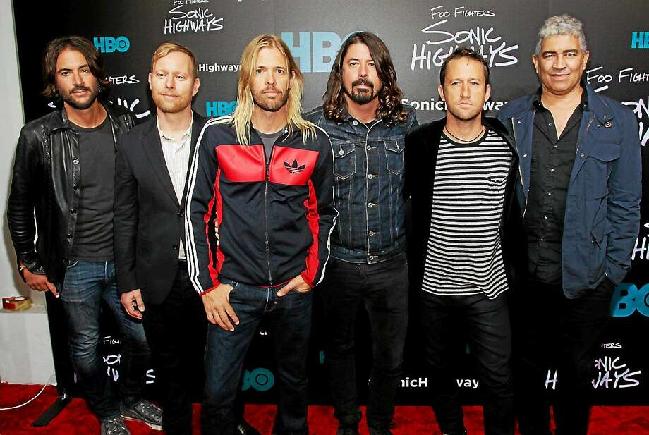 "Rami Jaffee, from left, Nate Mendel, Taylor Hawkins, Dave Grohl, Chris Shiflett and Pat Smear attend the premiere of HBO's ""Foo Fighters Sonic Highway"" on Oct. 14, 2014, in New York. Photo: Photo By Andy Kropa/Invision/AP  / Invision"