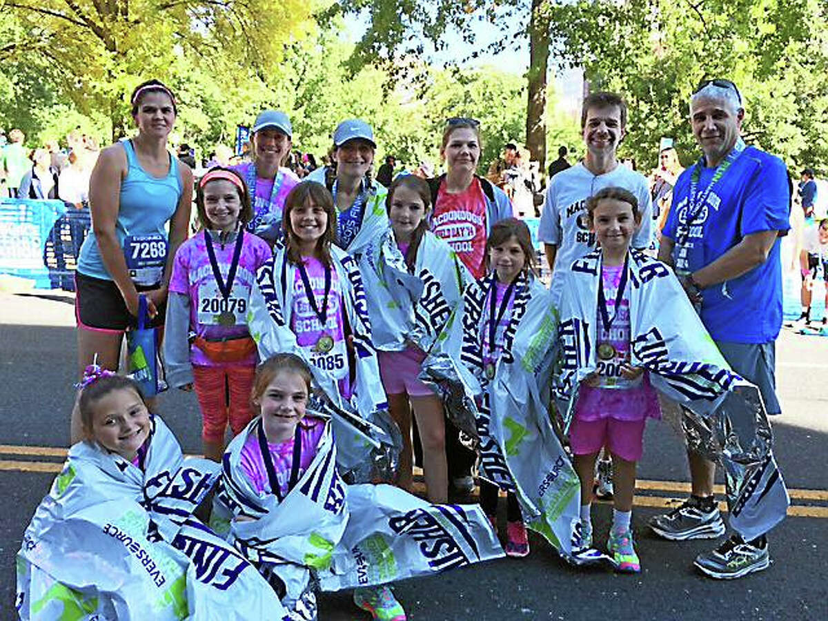 Middletown's Macdonough Elementary School students and teachers, along with Principal Jon Romeo, ran the Eversource Hartford Marathon Saturday at Bushnell Park in Hartford. Shown are: (all from left) lowest level: Meadow Eyles and Jenna Carfora; middle level: Elise Kennedy, Megan Ranno, Alyssa Elmeer, Taylor Wilks and Rena Johnson; and faculty Kelly Lenihan, Michelle Currier, Sarah Claffey, Elizabeth Waskiewicz, John Ferrero and Jon Romeo.