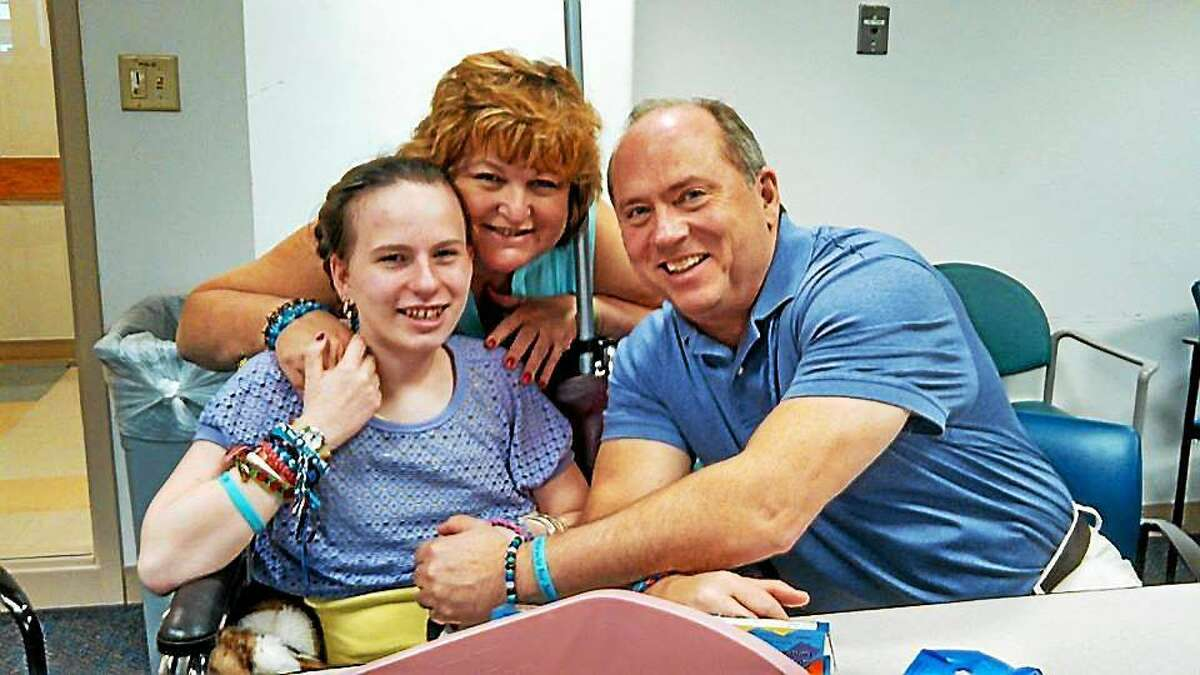 Linda and Lou Pelletier with their daughter Justina at Boston Children's Hospital.