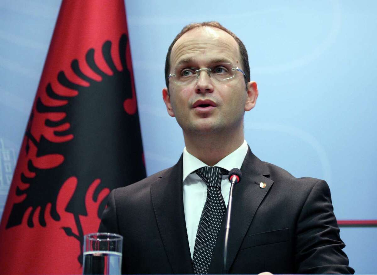Albanian Foreign Minister Ditmir Bushati speaks at a news conference in capital Tirana, Albania Wednesday, Oct. 15, 2014, strongly denouncing anti-Albanian slogans and the violence before, during and after the match with Serbia. It was all about the drone Wednesday ó the one that took off from an Orthodox Church in Belgrade and flew over a soccer stadium with a nationalist Albanian banner. It ignited more than a brawl between players and fans ó it inflamed years of simmering tensions between Balkan rivals Serbia and Albania. (AP Photo/Hektor Pustina)