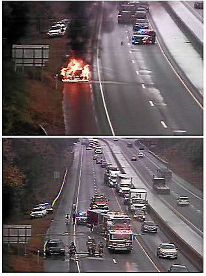 A car fire briefly shut down part of Interstate 95 near Exit 63 in Clinton late Tuesday morning. Fire crews were able to quickly extinguish the flames. Photo: Photos Via The Connecticut Department Of Transportation