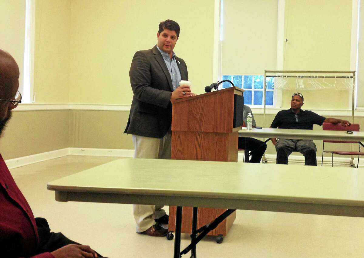 Middletown Mayor Dan Drew speaks at the deKoven House Wednesday evening about his intention to encourage people of color to apply for jobs in the city's public safety departments.