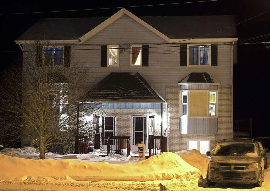 A car is parked outside a home on Tiger Maple Drive in Timberlea, Nova Scotia, a Halifax suburb, where police found a deceased person Friday, Feb. 13, 2015. A senior police official said Friday police foiled a plot by suspects who were planning on going to a mall and killing as many people as they could before killing themselves on Valentine's Day in Halifax. The official told The Associated Press the suspects were on a chat stream and were apparently obsessed with killing and death and had many photos of mass killings. (AP Photo/The Canadian Press, Andrew Vaughan) Photo: AP / The Canadian Press