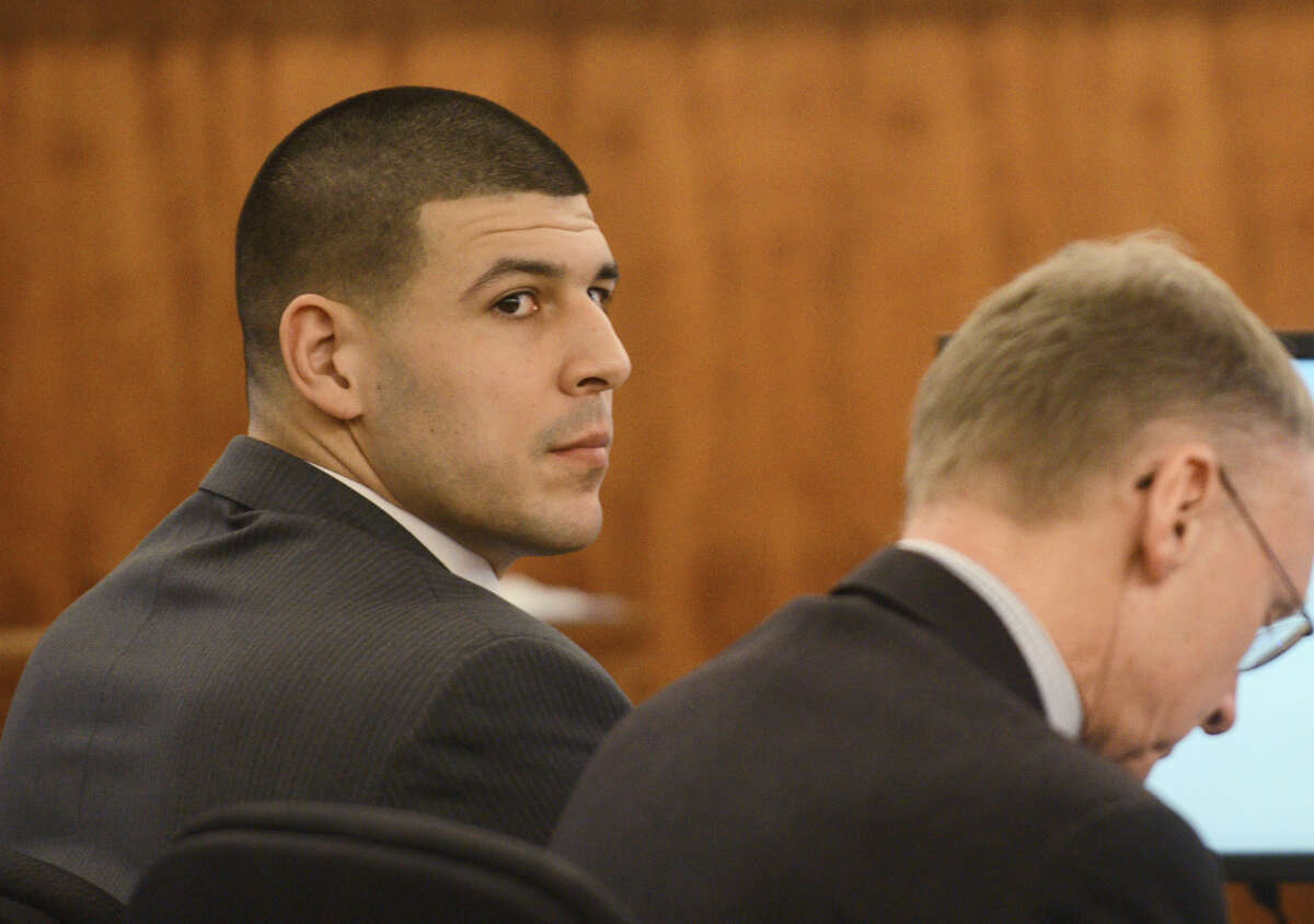 Aaron Hernandez, left, sits with his attorney, Charles Rankin, during his murder trial Wednesday at Bristol Superior Court in Fall River, Mass.