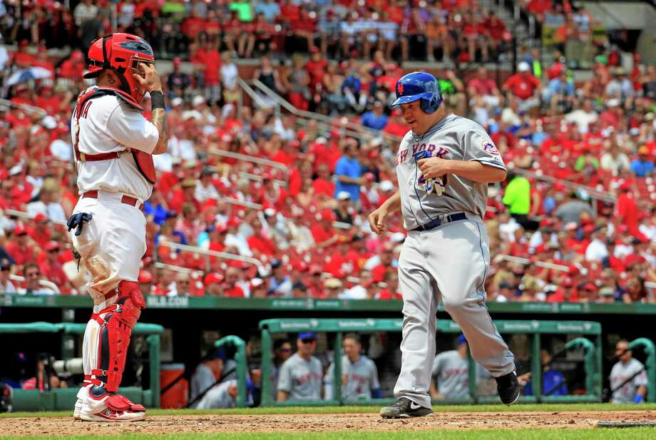 New York Mets starter Bartolo Colon scores on a double by Eric Young Jr. as Cardinals catcher Yadier Molina watches during the sixth inning of Wednesday's game in St. Louis. Photo: Jeff Roberson — The Associated Press  / AP