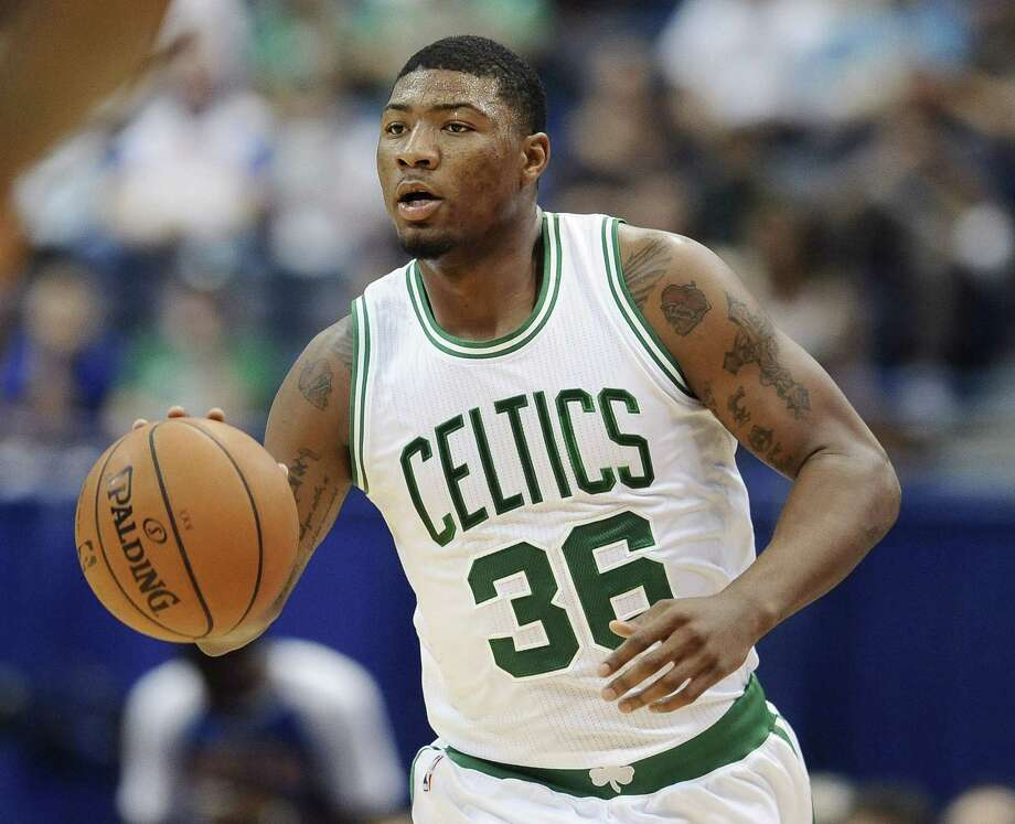 Marcus Smart and the Boston Celtics will play the Brooklyn Nets in a 44-minute exhibition game on Sunday. Photo: Jessica Hill — The Associated Press  / AP2014