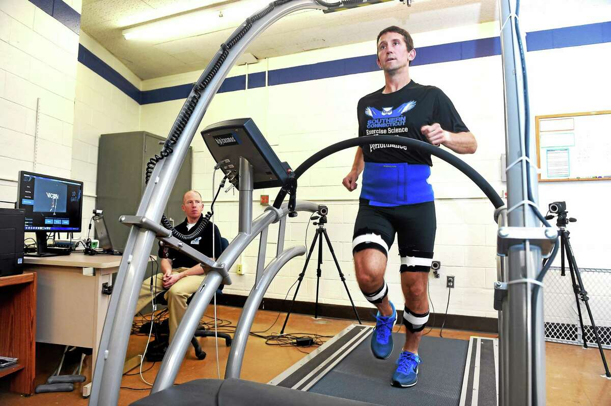 Robert Gregory, left, observes William Lunn on an instrumented treadmill in the Human Performance Laboratory at Southern Connecticut State's Moore Field House. Both men are assistant professors of exercise science. The treadmill is used to analyze walking and running mechanics for injury prevention.