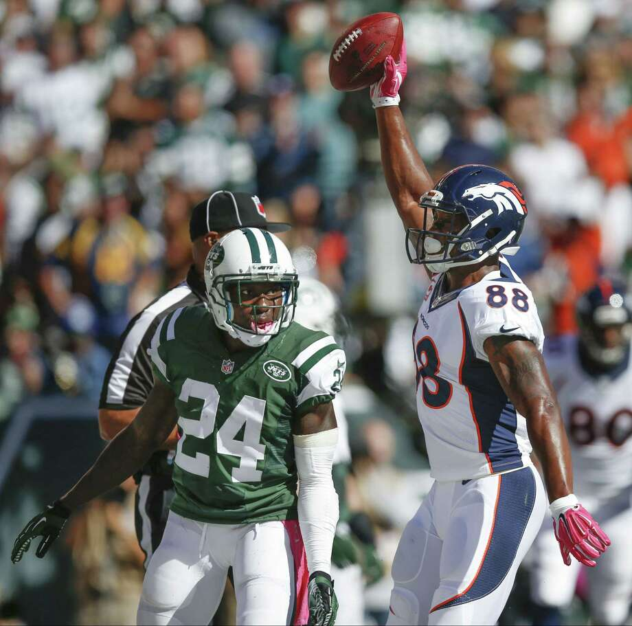 Denver Broncos receiver Demaryius Thomas (88) reacts after catching a touchdown pass against New York Jets defensive back Phillip Adams (24) in the second quarter Sunday in East Rutherford, N.J. Photo: Kathy Willens — The Associated Press  / AP