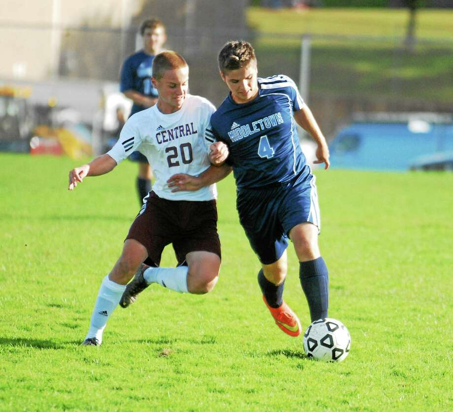 Middletown's Anthony Musumeci controls the ball against Bristol Central defender Zach Aldieri. Photo: Jimmy Zanor — Middletown Press