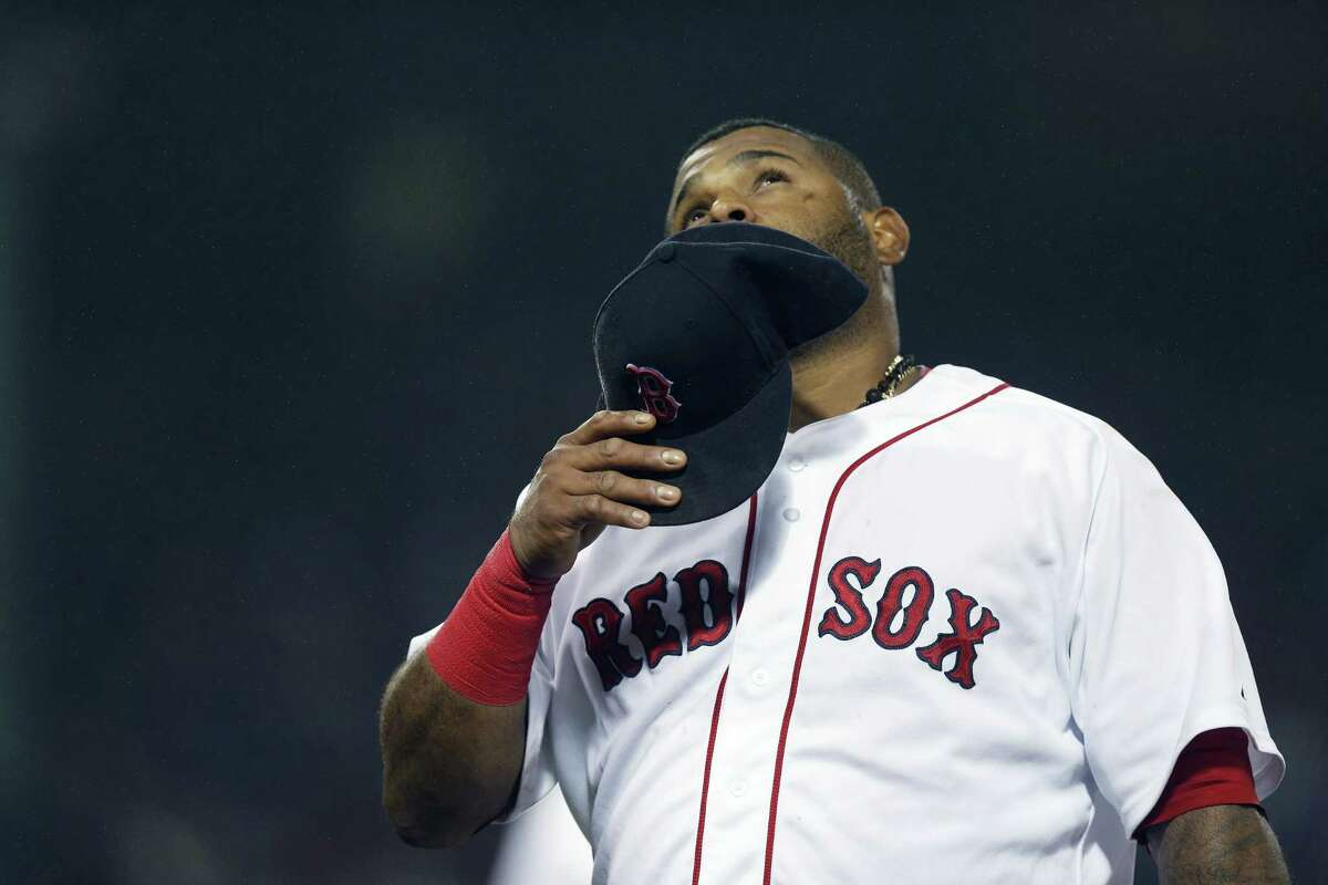 The Red Sox's Pablo Sandoval looks up as he walks to the dugout during the ninth inning of Monday's game against the Atlanta Braves in Boston.