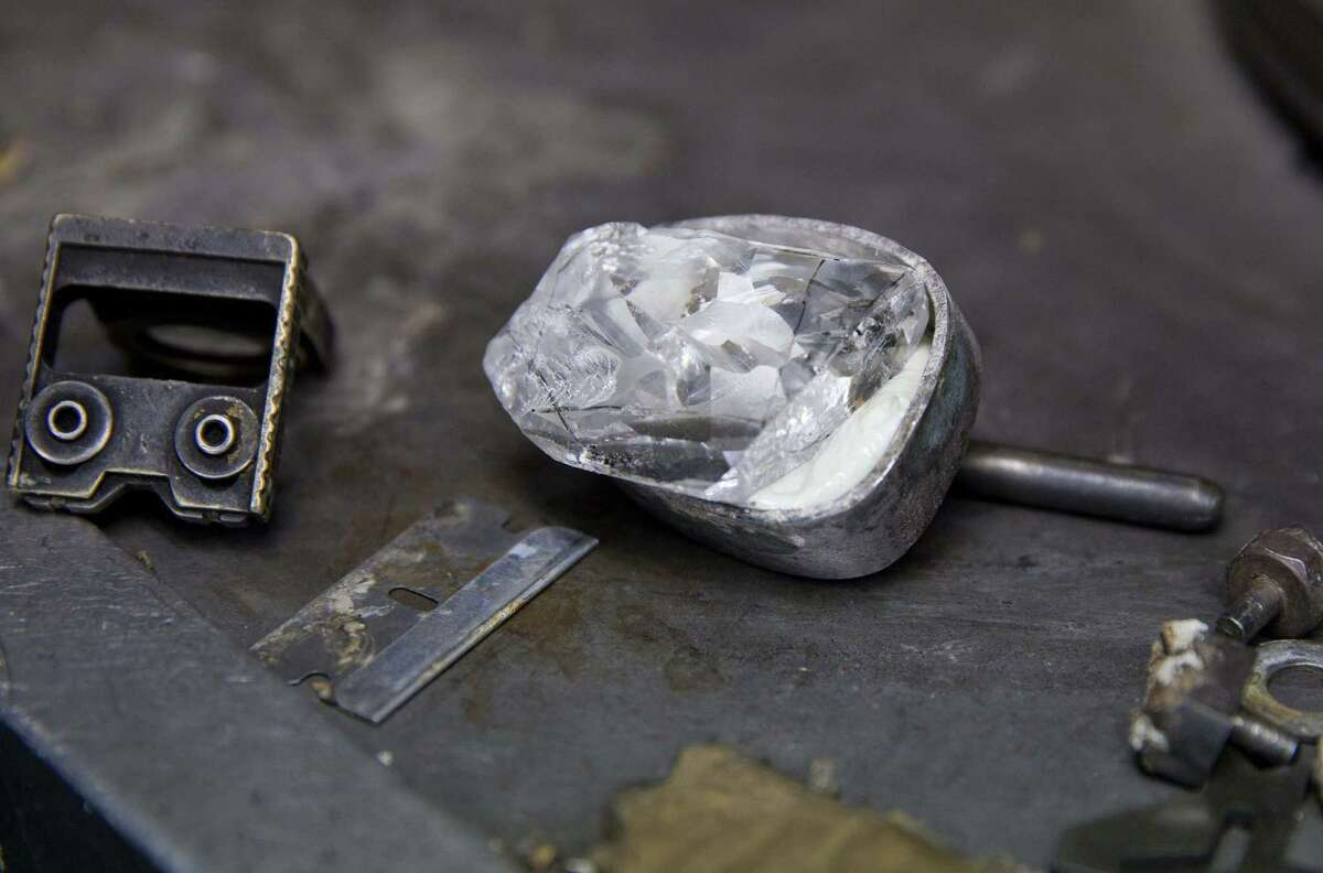 This undated photo provided by Sotheby's shows a white diamond before being crafted into an emerald-cut diamond, which Sothebyís will auction in New York on April 21 with predictions it could fetch $19 million to $25 million. The rare 100-carat emerald-cut diamond, which Sothebyís says is internally flawless and is considered ìperfect,î was mined in South Africa and weighed over 200 carats in the rough. (AP Photo/Sotheby's)