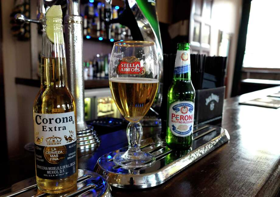 Drinks sit on the bar in a pub in London Tuesday. Photo: Kirsty Wigglesworth — The Associated Press  / AP