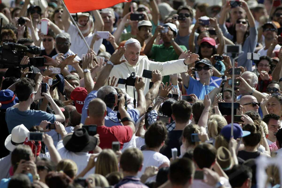 Pope Francis arrives to celebrate his weekly general audience, in St. Peter's Square at the Vatican, Wednesday, June 17, 2015. (AP Photo/Andrew Medichini)