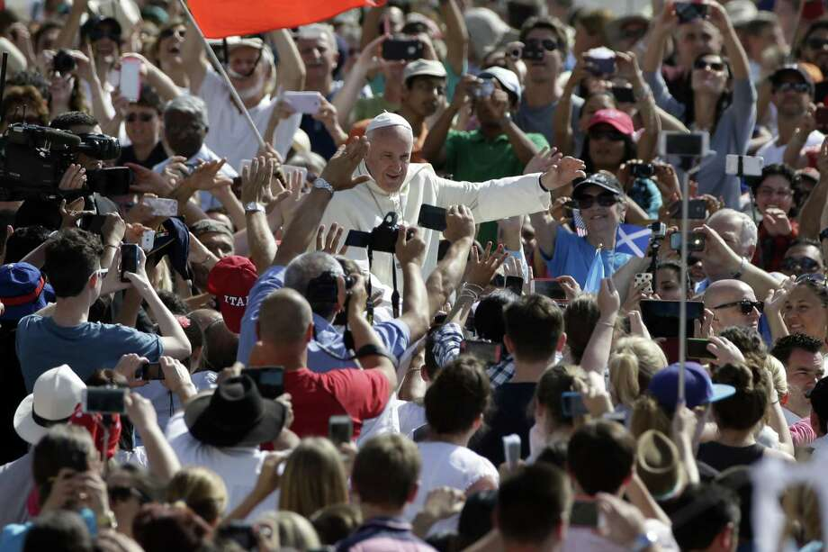 Pope Francis arrives to celebrate his weekly general audience, in St. Peter's Square at the Vatican,  Wednesday, June 17, 2015. (AP Photo/Andrew Medichini) Photo: AP / AP