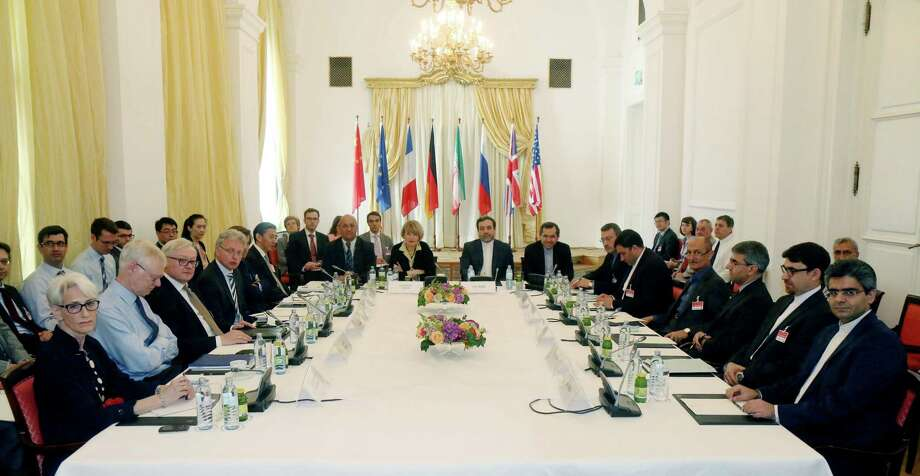 FILE - In this Friday, June 12, 2015 file photo delegates sit around a table prior to a bilateral meeting as part of the closed-door nuclear talks with Iran at a hotel in Vienna, Austria. Iran and six powers are still apart on all main elements of a nuclear deal with less than two weeks to go to their June 30 target date and will likely have to extend their negotiations, two diplomats tell The Associated Press. (AP Photo/Ronald Zak, File) Photo: AP / AP
