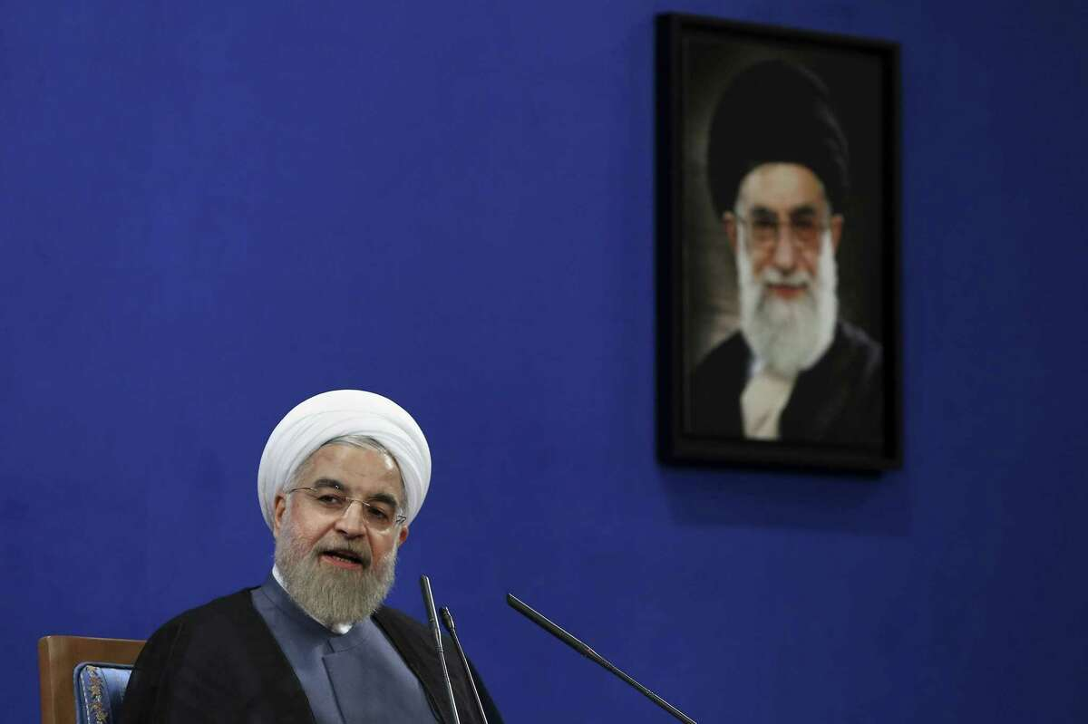 Iranian President Hassan Rouhani speaks during a press conference on the second anniversary of his election, in Tehran, Iran, Saturday, June 13, 2015. Rouhani said a final nuclear deal is