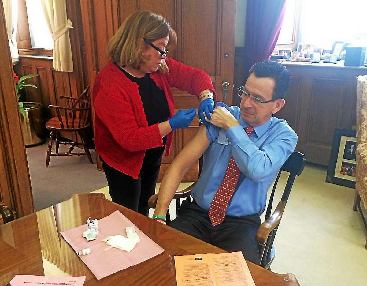 Gov. Dannel P. Malloy receives a flu shot Feb. 6 in a photo posted to Twitter.