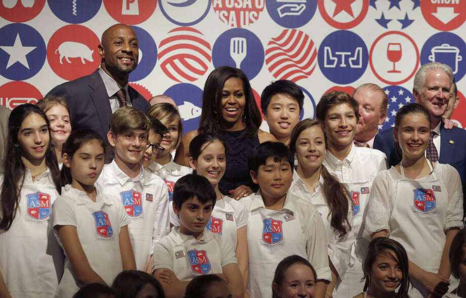 U.S. first lady Michelle Obama poses after a cooking demonstration at the James Beard American Restaurant with Italian and American middle school students in Milan, Italy, Wednesday, June 17, 2015.  Michelle Obama is in Milan on the second leg of a European trip that puts an international spin on her core initiatives. (AP Photo/Antonio Calanni) Photo: AP / AP