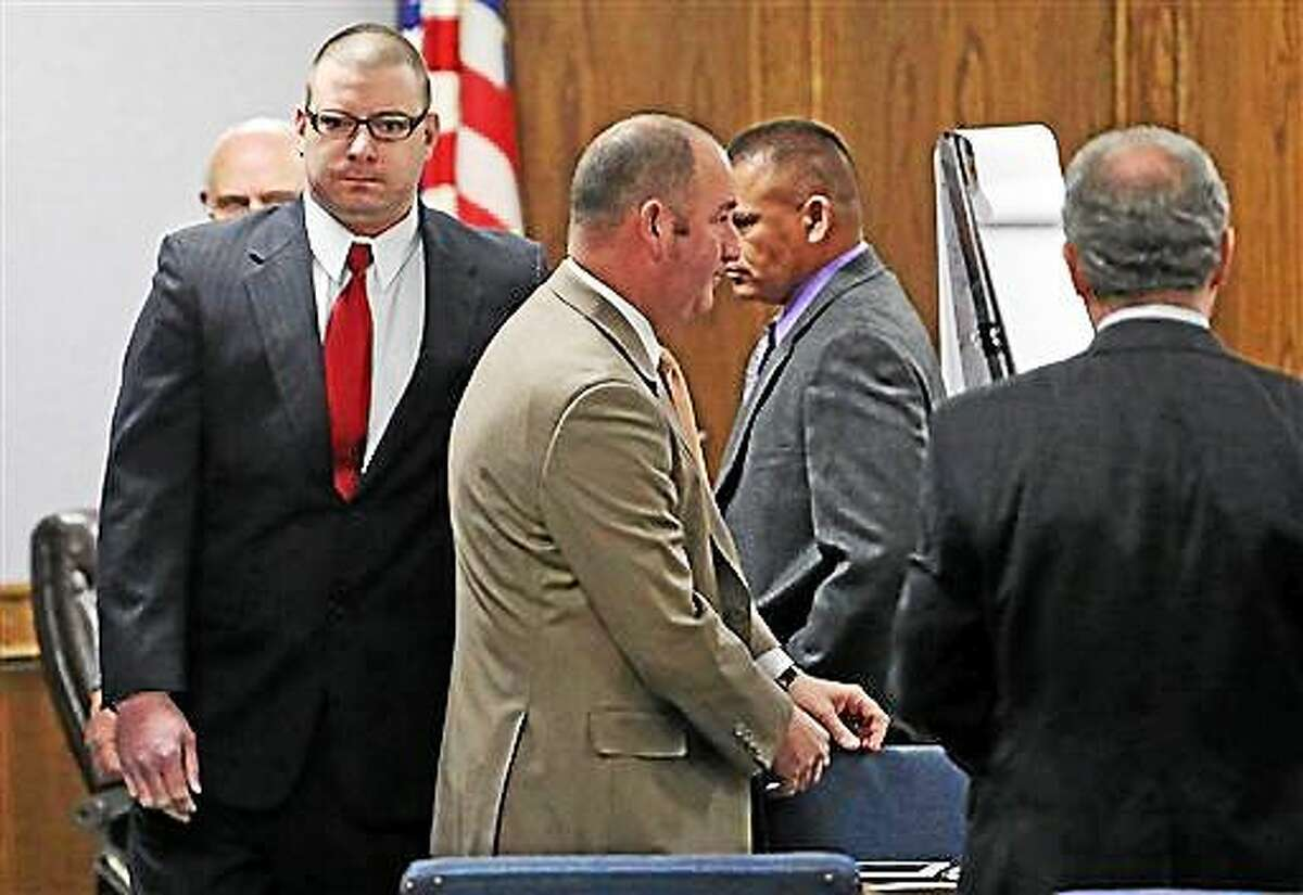 Former Marine Cpl. Eddie Ray Routh, left, enters the courtroom for his capital murder trial at the Erath County, Donald R. Jones Justice Center in Stephenville, Texas, Friday, Feb. 13, 2015. Routh, 27, of Lancaster, is charged with the 2013 deaths of former Navy SEAL Chris Kyle and his friend Chad Littlefield at a shooting range near Glen Rose, Texas.