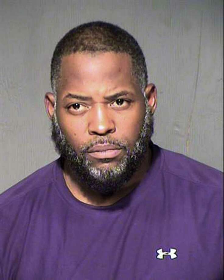This undated law enforcement booking photo from the Maricopa County, Ariz., Sheriff's Department shows Abdul Malik Abdul Kareem. Kareem, 43, also known as Decarus Thomas, has been charged with helping plan an attack on a provocative Prophet Muhammad cartoon contest in Texas that ended with two men being killed in a shootout with police. An indictment filed in federal court in Phoenix alleges that Kareem hosted the gunmen in his home beginning in January and provided the guns they used in the May 3 shooting in Garland, Texas.(Maricopa County Sheriff's Department via AP) Photo: AP / Maricopa County Sheriff's Department
