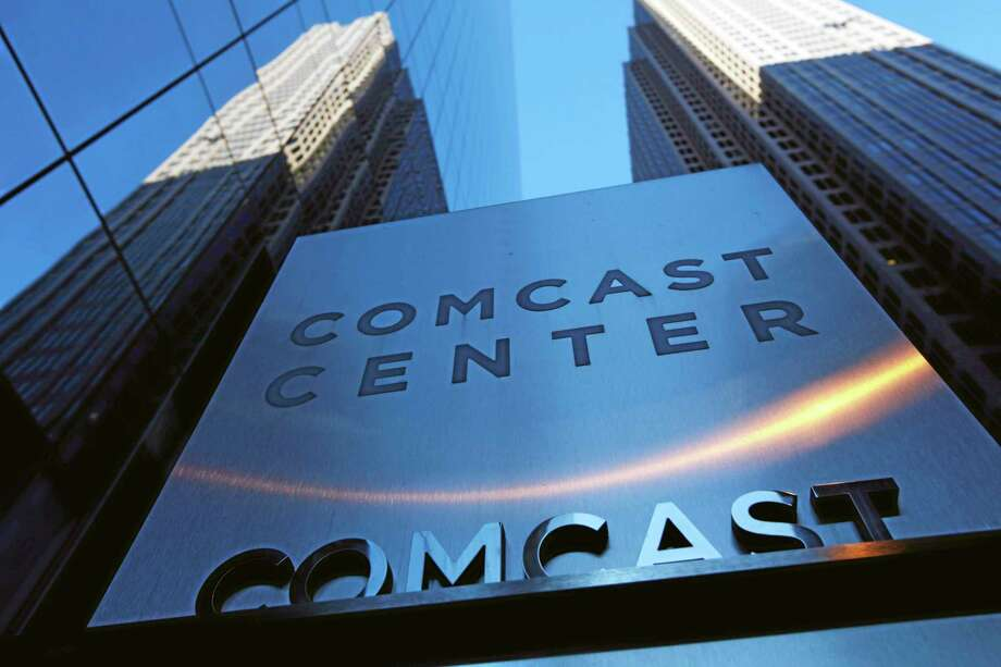 In this Dec. 3, 2009, file photo, a sign outside the Comcast Center, left, is shown in Philadelphia. Photo: AP File Photo  / AP