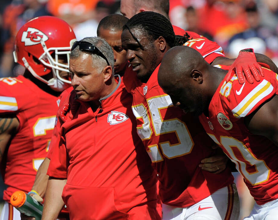 Kansas City Chiefs running back Jamaal Charles is helped off Sunday. Photo: Ed Zurga — The Associated Press  / FR34145 AP