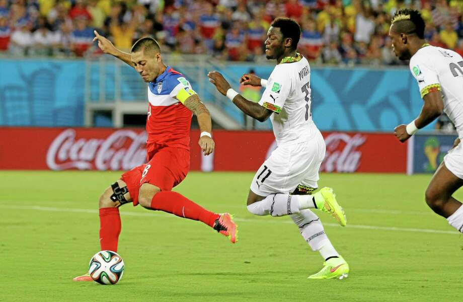 The United States' Clint Dempsey shoots and scores the opening goal Monday during the group G World Cup match against Ghana at the Arena das Dunas in Natal, Brazil. Photo: Ricardo Mazalan — The Associated Press  / AP