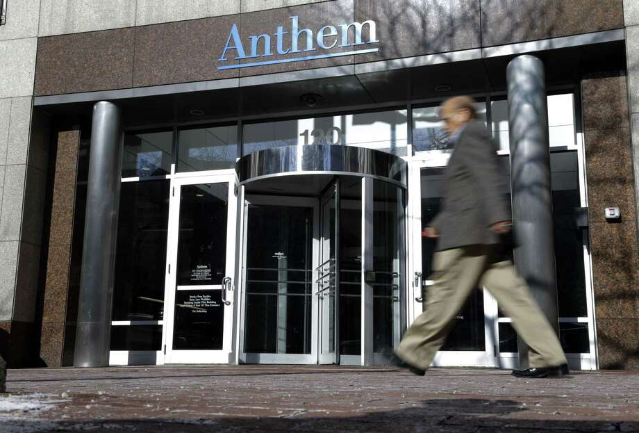 A man walks past health insurer Anthem's corporate headquarters in Indianapolis, Thursday, Feb. 5, 2015. Hackers broke into the company's database storing information for about 80 million people in an attack bound to stoke fears many Americans have about the privacy of their most sensitive information. Photo: The Associated Press / AP