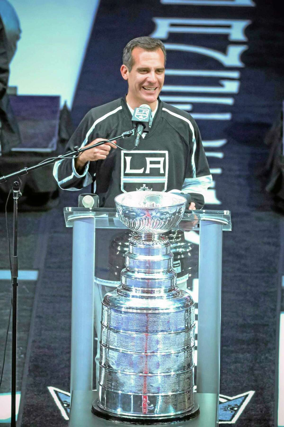 In this photo taken on Monday, Los Angeles Mayor Eric Garcetti talks to the crowd during the Los Angeles Kings' Stanley Cup championship rally at Staples Center. Mayor Garcetti used the F-bomb in declaring it a big day for LA, bringing 19,000 hockey fans to their feet, lighting up the Twitterverse in delight and leaving some folks scratching their heads, wondering just what the heck the normally soft-spoken elected official was thinking.
