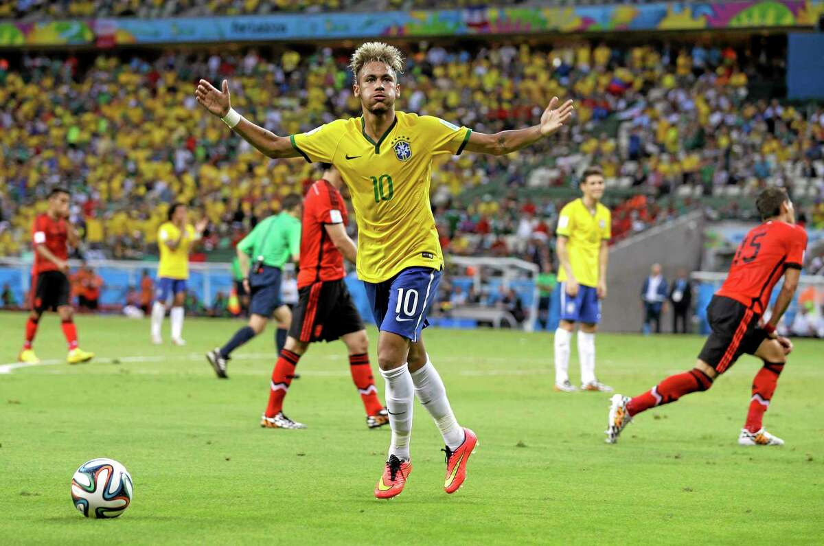 Brazil's Neymar tries to lift the crowd during the group A World Cup match against Mexico Tuesday at the Arena Castelao in Fortaleza, Brazil.