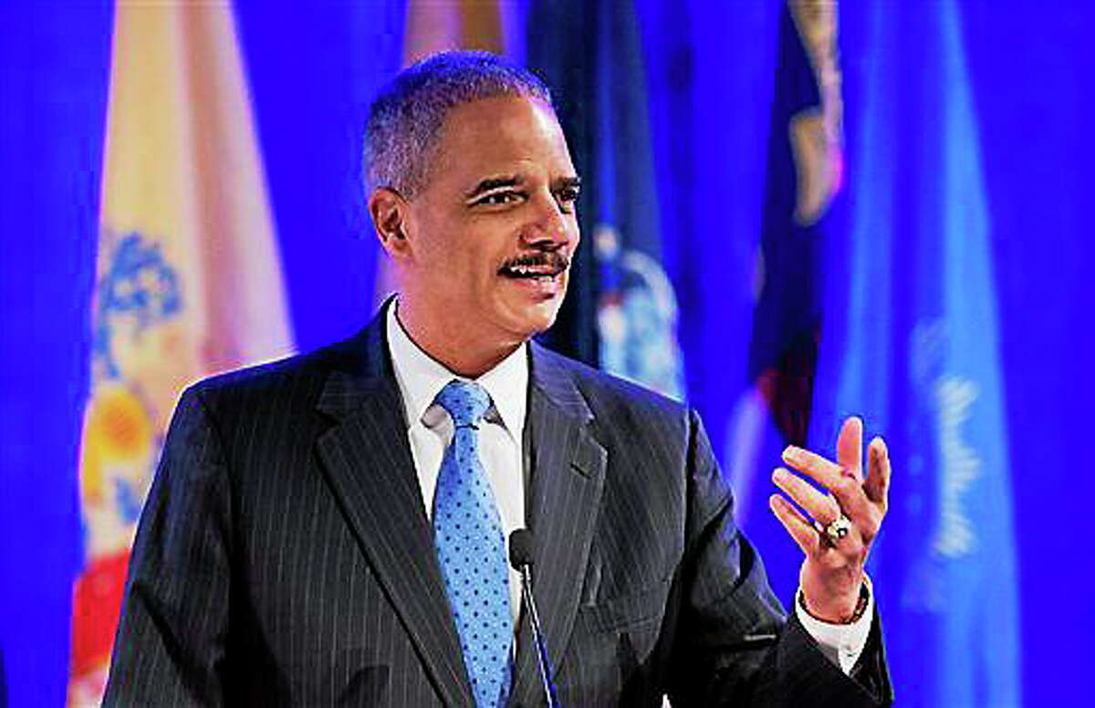 Attorney General Eric Holder speaks at the annual Attorneys General Winter Meeting in Washington, Tuesday, Feb. 25, 2014. Holder said state attorneys general are not obligated to defend laws in their states banning same sex-marriage if they don't believe in them.