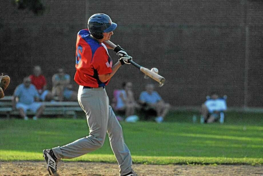 Jimmy Zanor - Middletown Press Post 75's Jared Pflaumer makes contact Tuesday night at Guilford. Photo: Journal Register Co.