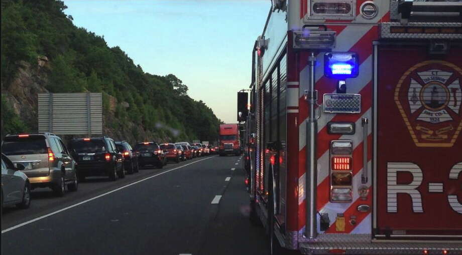 Vehicles were forced to exit Route 9 northbound between Exits 2 and 3 after a motorcycle crash Monday. Photo: Photo Courtesy Of The Old Saybrook Fire Department