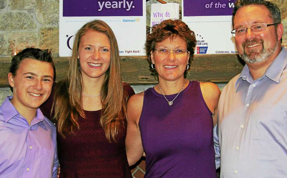 Teams are ready to walk the Durham Fairgrounds June 20 during the first Middlefield/Durham Relay for Life. Dressed in purple, event co-organizers and mother-daughter team (center, left to right) Emily and Debbie Sokol pose with family at the kickoff celebration. Photo: Journal Register Co.