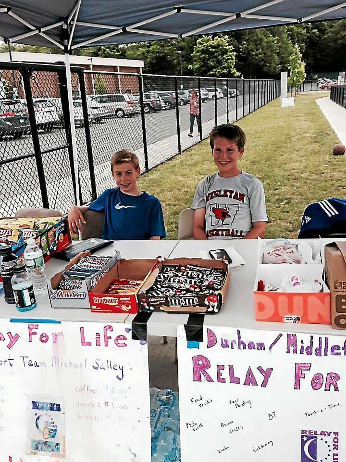 Michael and Jason Salley spent time fundraising with their teams at the Coginchaug High School track on a recent Saturday morning.