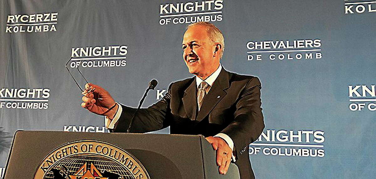 Supreme Knight Carl Anderson addresses the deputies meeting.