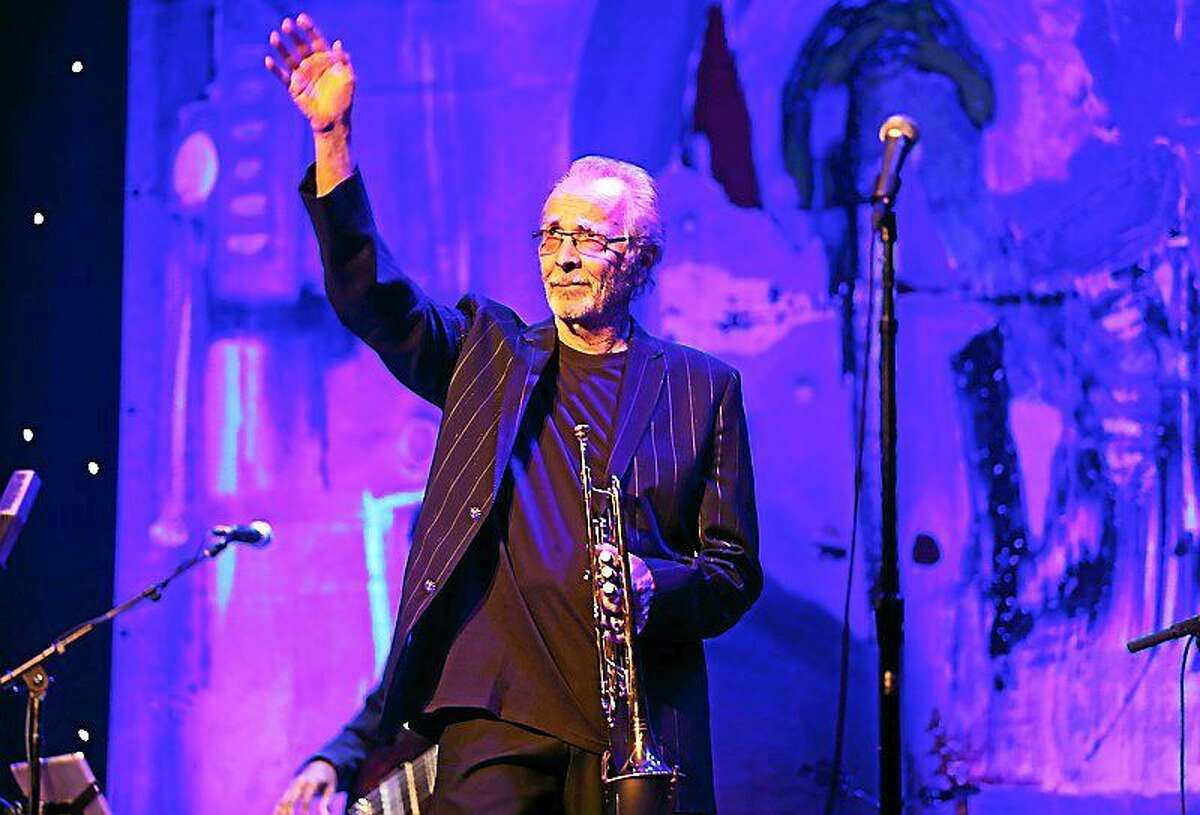 """Trumpeter Herb Albert is shown walking on stage during the start of his live concert appearance at Infinity Hall in downtown Hartford on Oct. 11. This sold-out show was the opening night of Herbís U.S. concert tour in support of his new album """"In The Mood."""""""