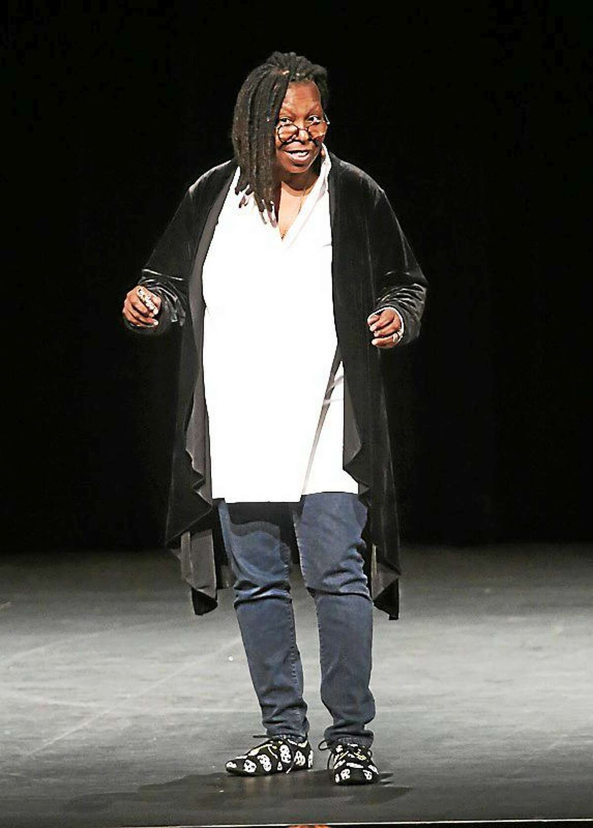 Comedian Whoopi Goldberg, born Caryn Elaine Johnson, is shown performing on stage during her live appearance at the Grand Theater in the Foxwoods Resort & Casino on Oct. 10.