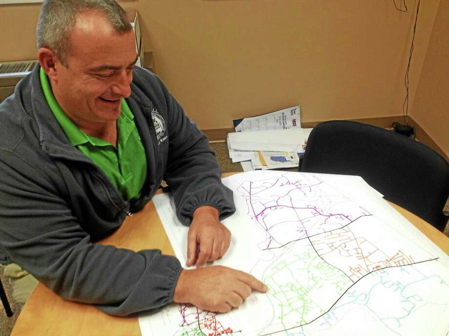 Cromwell Public Works Director Louis Spina shows a map which designates certain zones in town, each of which will be used for bulky pickup. Photo: Jeff Mill — The Middletown Press